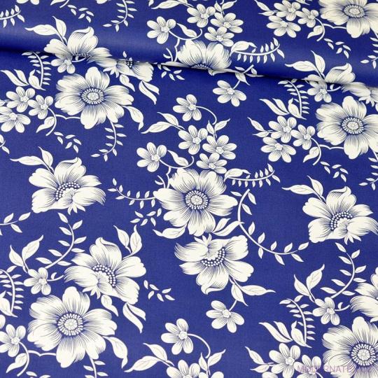 Tkanina bawełniana wzór białe kwiaty na niebieskim tle