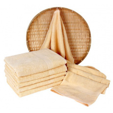 Kremowy ręcznik frotte Darsi - 50x100 cm